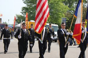 Images of senior veterans on a parade